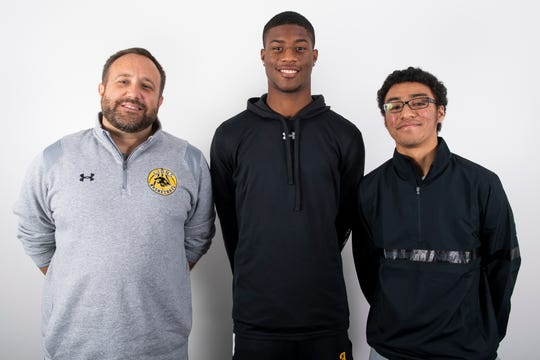(From left) Red Lion boys' basketball head coach Steve Schmehl and players Davante Dennis and AJ Virata pose in the GameTimePA photo booth during YAIAA winter sports media day at the York Daily Record on Sunday, November 17, 2019.