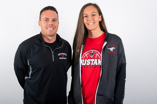 South Western girls' basketball head coach Kevin Klunk and player Maddie Lehker pose in the GameTimePA photo booth during YAIAA winter sports media day at the York Daily Record on Sunday, November 17, 2019.