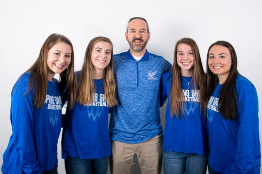 (From left) Spring Grove girls' basketball team members Ellie Glass, Lexi Hoffman, head coach Troy Sowers, Ella Kale and Haley Wagman pose in the GameTimePA photo booth during YAIAA winter sports media day at the York Daily Record on Sunday, November 17, 2019.