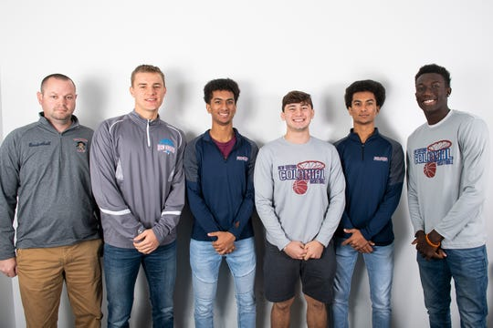 (From left) New Oxford boys' basketball head coach Nate Myers and players Brayden Long, Dawuan Golden, Noah Strausbaugh, Tayshawn Golden and Abdul Janneh pose in the GameTimePA photo booth during YAIAA winter sports media day at the York Daily Record on Sunday, November 17, 2019.