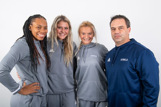 (From left) West York girls' basketball players Alayna Harris, Alyssa Zorbaugh and Makennah Hoffman pose with head coach James Kunkle in the GameTimePA photo booth during YAIAA winter sports media day at the York Daily Record on Sunday, November 17, 2019.