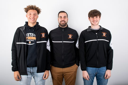 (From left) York Suburban boys' basketball team members Aidan Hughley, assistant coach Mitch Kemp and RJ Marquis pose in the GameTimePA photo booth during YAIAA winter sports media day at the York Daily Record on Sunday, November 17, 2019.