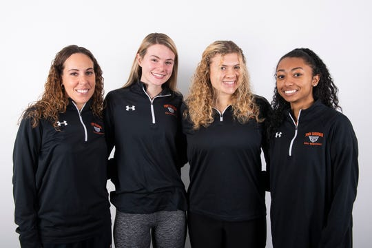 (From left) York Suburban girls' basketball head coach Jess Barley poses with players Lulu Mooney, Alyssa Hocker and Kiyanna Dowling in the GameTimePA photo booth during YAIAA winter sports media day at the York Daily Record on Sunday, November 17, 2019.