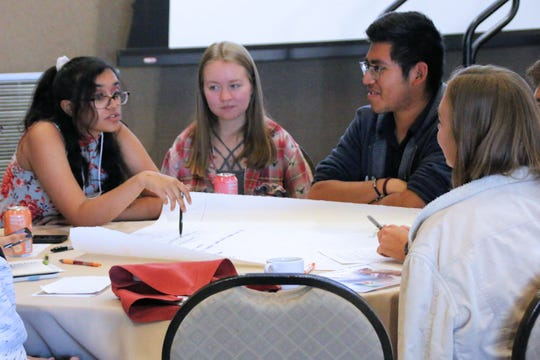 "Aditi Narayanan (left) discusses ideas for economic solutions to address climate change, along with Ryan Harrop (center) and Brian Mecinas (right) during the youth forum at the conference ""Climate 2020: Seven Generations for Arizona"" at Northern Arizona University in Flagstaff on Nov. 16, 2019."