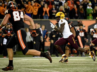 Arizona State wide receiver Brandon Aiyuk runs a punt back for a touchdown as Oregon State tight end Teagan Quitoriano gives chase during the first half of an NCAA college football game in Corvallis, Ore., Saturday, Nov. 16, 2019.