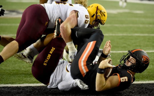 Oregon State quarterback Jake Luton (6) is sacked by Arizona State defensive linemen Jermayne Lole and Roe Wilkins during the first half of an NCAA college football game in Corvallis, Ore., Saturday, Nov. 16, 2019.