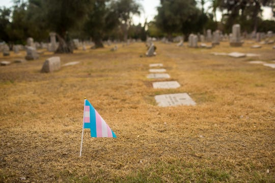 Trans pride flags line the path during a ceremony to place a headstone for Nicolai De Raylan Saturday, Nov. 16, 2019 at Greenwood Memory Lawn Mortuary & Cemetery in Phoenix.