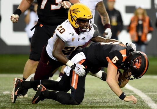 Oregon State quarterback Jake Luton is sacked by ASU linebacker Khaylan Kearse-Thomas during a game Nov. 16.