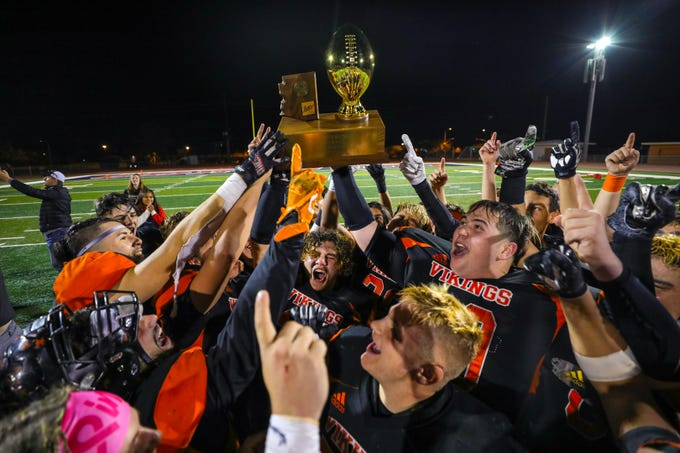 The Williams Vikings celebrate after defeating the Superior Panthers in the Class A State Championship on Nov. 16, 2019 in Phoenix, AZ. (Brady Klain/The Republic)