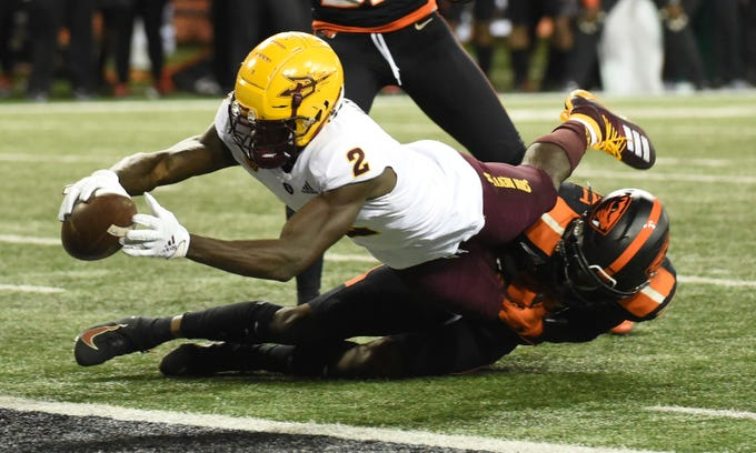 Arizona State wide receiver Brandon Aiyuk dives into the end zone as Oregon State defensive back Nahshon Wright tries to tackle him during the second half of an NCAA college football game in Corvallis, Ore., Saturday, Nov. 16, 2019. Oregon State won 35-34.