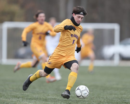 Rhinebeck's Noah Lortie (1) works the ball up field during their 1-0 win over Lansing  in the NYSPHSAA boys Class C state soccer final at Middletown High School on Sunday, November 17, 2019.