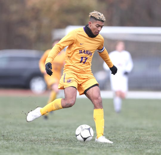 Rhinebeck's Nakoa Zuger (17) controls the ball during their 1-0 win over Lansing in the NYSPHSAA boys Class C state soccer final at Middletown High School on Sunday, November 17, 2019.