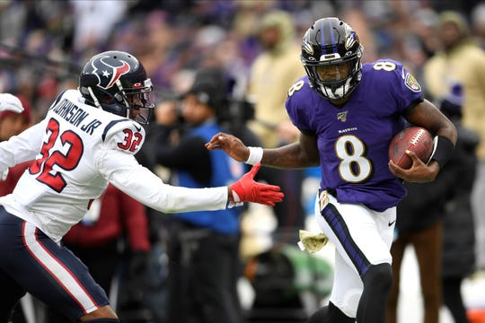 Baltimore Ravens quarterback Lamar Jackson (8) runs out of bounds as Houston Texans cornerback Lonnie Johnson (32) tries to stop him during the first half of an NFL football game, Sunday, Nov. 17, 2019, in Baltimore. (AP Photo/Nick Wass)