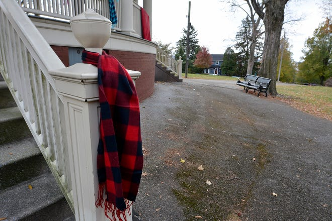 Hundreds of donated scarves, hats, jackets, blankets and more are hung around the band shell at Farquhar Park for the homeless and less fortunate, Sunday, November 17, 2019.John A. Pavoncello photo