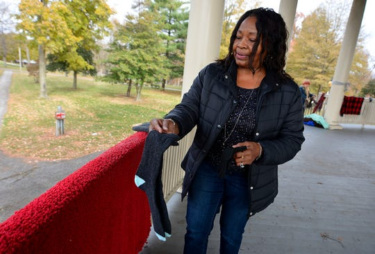 """""""I just wanted to stop on my way to church to bless somebody,"""" said Susan House of York as she hung donated socks, scarves, hats, jackets, blankets and more around the band shell at Farquhar Park for the homeless and less fortunate, Sunday, November 17, 2019.John A. Pavoncello photo"""