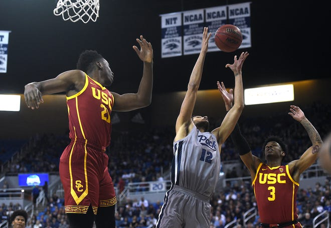 Nevada's Johncarlos Reyes (12) grabs a rebound against USC on Saturday night at Lawlor Events Center.