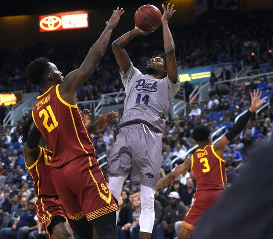 Nevada's Lindsey Drew shoots against USC on Saturday night. He finished with 12 points and five assists.