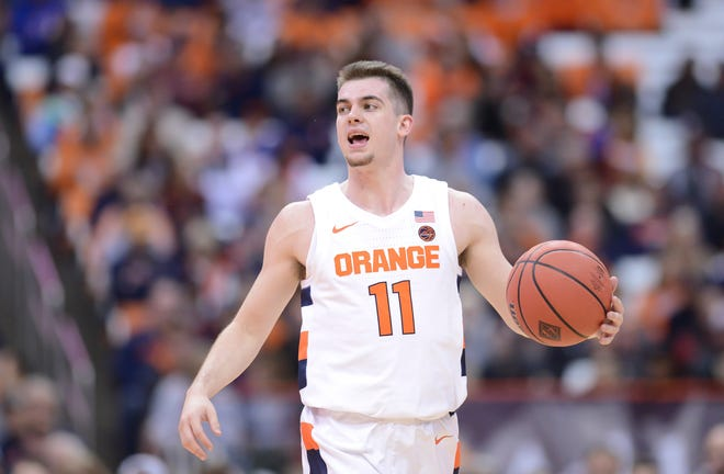 Syracuse Orange guard Joseph Girard III (11) brings the ball up court against the Seattle Redhawks in the second half at the Carrier Dome on Saturday, Girard scored a career-high 24 points in his first start.