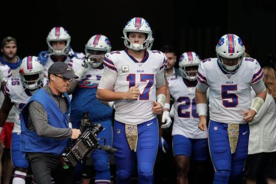 Buffalo Bills quarterback Josh Allen (17) enters the field, before an NFL football game against the Miami Dolphins, Sunday, Nov. 17, 2019, in Miami Gardens, Fla. (AP Photo/Lynne Sladky)