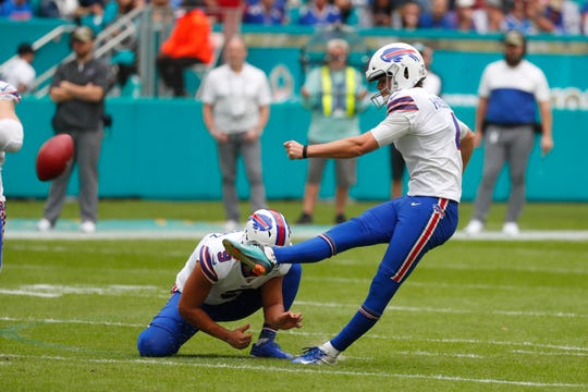 Buffalo Bills kicker Stephen Hauschka (4) kicks a field goal, during the first half at an NFL football game against the Miami Dolphins, Sunday, Nov. 17, 2019, in Miami Gardens, Fla. Buffalo Bills punter Corey Bojorquez (9) holds. (AP Photo/Wilfredo Lee)