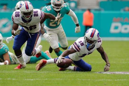 Buffalo Bills wide receiver John Brown (15) recovers a fumble by Buffalo Bills running back Devin Singletary (26), during the first half at an NFL football game against the Miami Dolphins, Sunday, Nov. 17, 2019, in Miami Gardens, Fla.