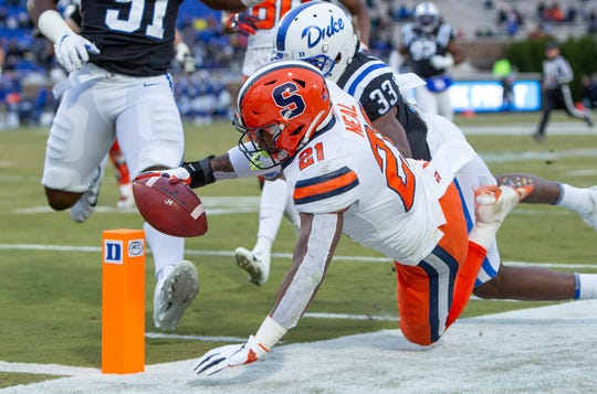 Syracuse's Moe Neal (21) dives towards the goal line during the first half of an NCAA college football game against Duke in Durham, N.C., Saturday, Nov. 16, 2019. Neal's run was ruled just short of the goal line but Syracuse still won, 49-6.