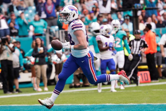Buffalo Bills tight end Dawson Knox (88) runs for a touchdown, during the first half at an NFL football game against the Miami Dolphins, Sunday, Nov. 17, 2019, in Miami Gardens, Fla.