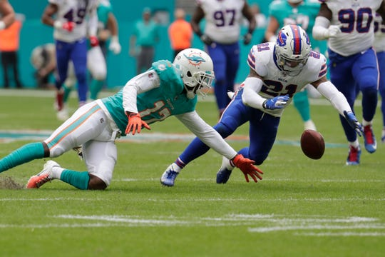 Buffalo Bills free safety Jordan Poyer (21) recovers a fumble by Miami Dolphins wide receiver Allen Hurns (17), during the first half at an NFL football game, Sunday, Nov. 17, 2019, in Miami Gardens, Fla.