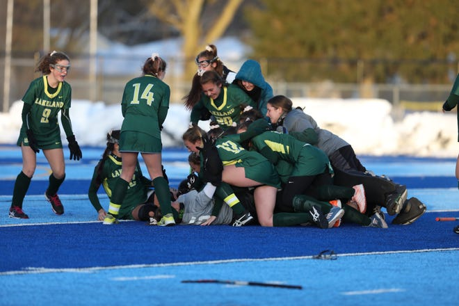 Lakeland field hockey players celebrate their 2-0 victory over Garden City on Saturday. Lakeland has won 10 state titles in 11 years.
