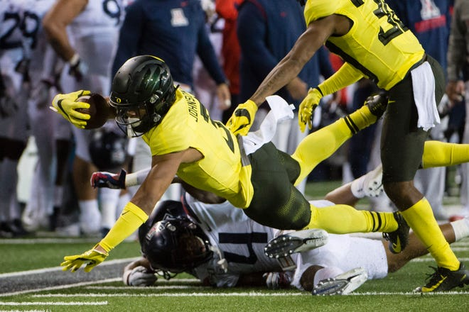 Nov 16, 2019; Eugene, OR, USA; Oregon Ducks wide receiver Johnny Johnson III (3) picks up yardage during the first half against the Arizona Wildcats at Autzen Stadium. Mandatory Credit: Troy Wayrynen-USA TODAY Sports