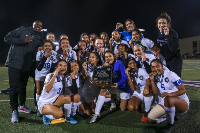 The Woodburn girls soccer team is euphoric after winning their first state championship title in the program's history, against Marist, on Nov. 16 at Liberty High School in Hillsboro. Woodburn won 1-0.