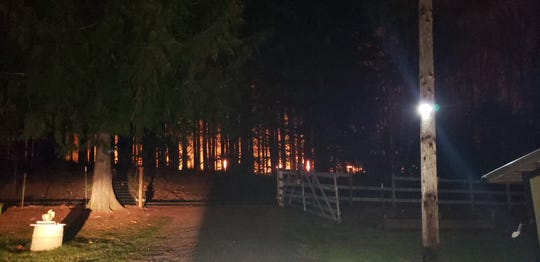 A 10-acre brush fire ignited Saturday evening threatening several homes in rural Marion County.
