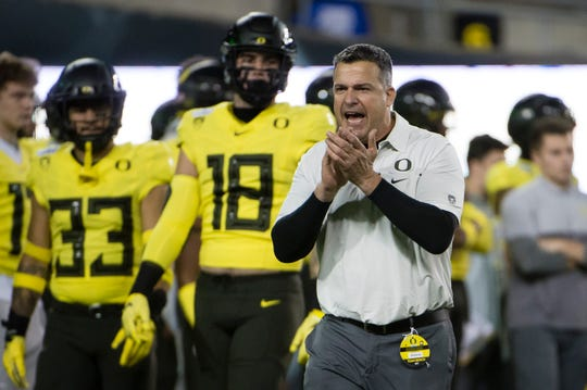 Nov 16, 2019; Eugene, OR, USA; Oregon Ducks head coach Mario Cristobal encourages his players before a game against the Arizona Wildcats at Autzen Stadium. Mandatory Credit: Troy Wayrynen-USA TODAY Sports