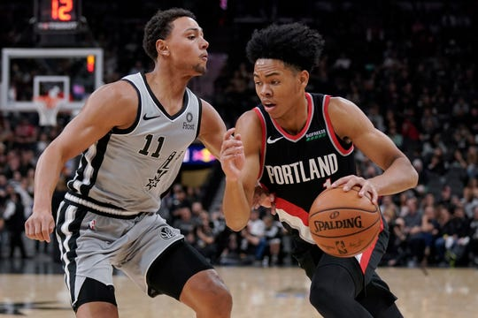 Portland Trail Blazers' Anfernee Simons, right, drives against San Antonio Spurs' Bryn Forbes during the first half of an NBA basketball game, Saturday, Nov. 16, 2019, in San Antonio.