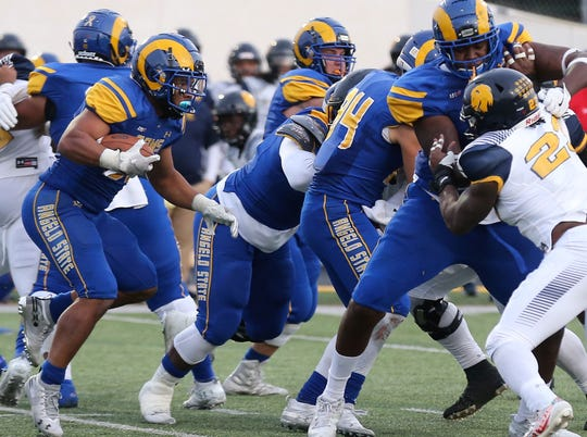 Angelo State University running back Daven Manning follows his blockers during a Lone Star Conference showdown with No. 23 Texas A&M-Commerce in the Rams' season finale at the LeGrand Stadium at 1st Community Credit Union Field on Saturday, Nov. 16, 2019.