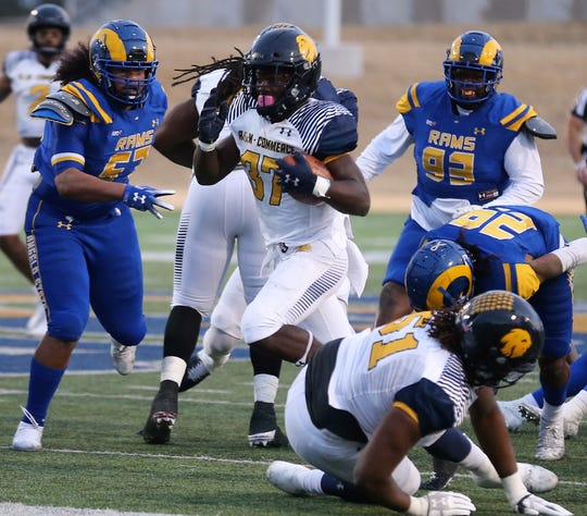 The Angelo State University defense tries to corral Texas A&M-Commerce running back Jemal Williams during the Lone Star Conference finale at LeGrand Stadium at 1st Community Credit Union Field on Saturday, Nov. 16, 2019.