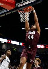 Missouri State forward Gaige Prim (44) dunks over Xavier forward Tyrique Jones, left, during the second half of an NCAA college basketball game, Friday Nov. 15, 2019, in Cincinnati. (AP Photo/Gary Landers)