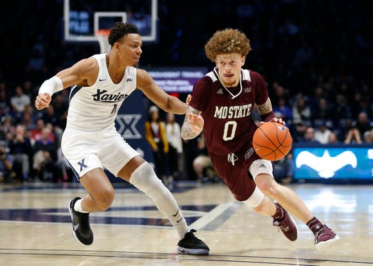 Missouri State guard Tyrik Dixon (0) drives the ball around Xavier guard Bryce Moore (11) during the second half of an NCAA college basketball game, Friday Nov. 15, 2019, in Cincinnati. (AP Photo/Gary Landers)