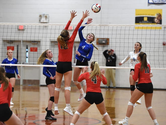 Lani Goggin (4) battles at the net in Fort Defiance's season-ending loss to Lord Botetourt Saturday, November 16, in the Class 3 state quarterfinals.