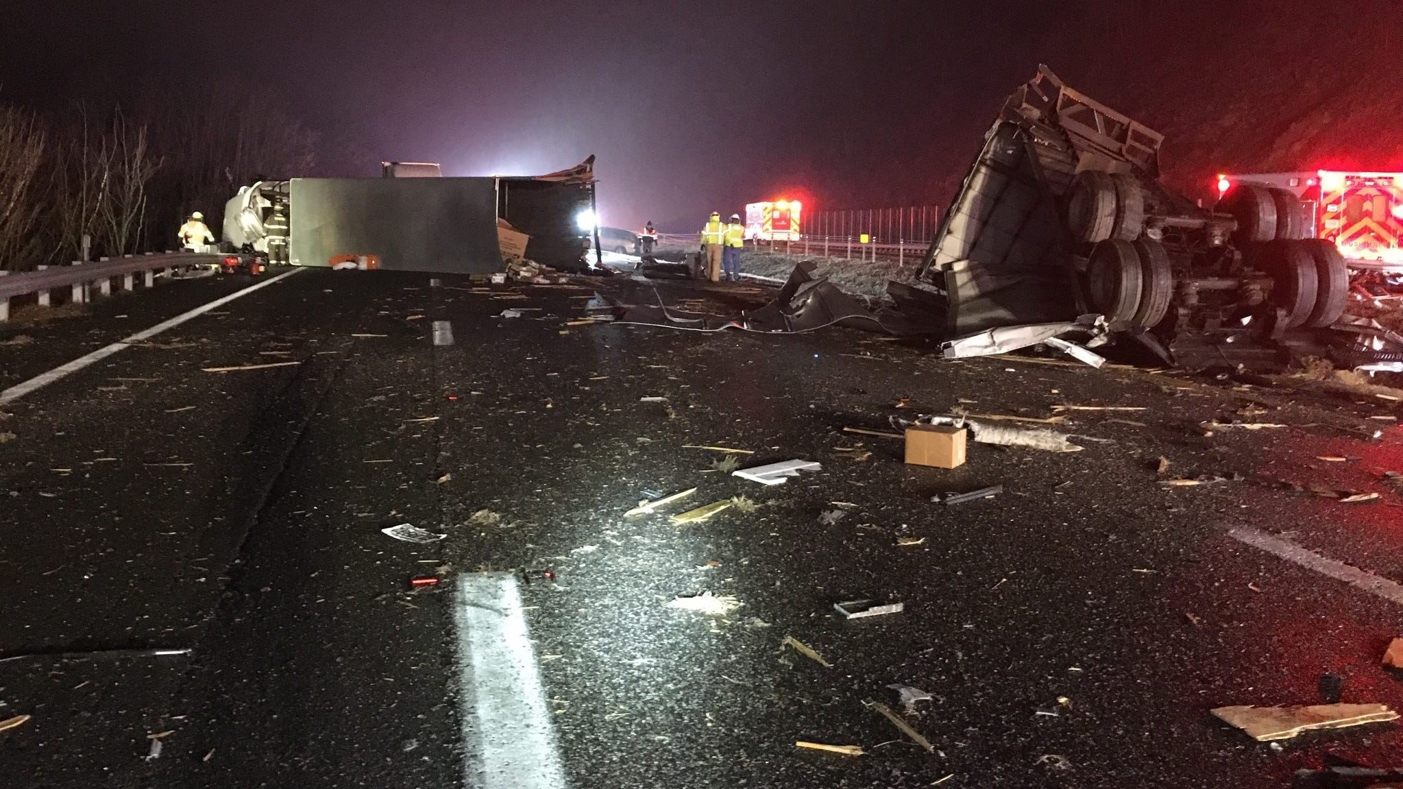 Tractor-trailer split in half by bus on I-64, 19 injured