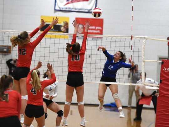 Maggie Trainum (12) with an attack in Fort Defiance's season-ending loss to Lord Botetourt Saturday, November 16, in the Class 3 state quarterfinals.