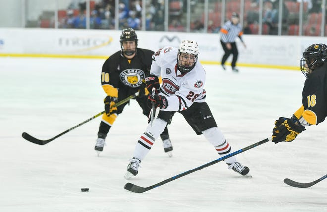 St. Cloud State's Kevin Fitzgerald passes the puck during the first period of the Saturday, Nov. 16, 2019, game against Colorado College at the Herb Brooks National Hockey Center in St. Cloud.