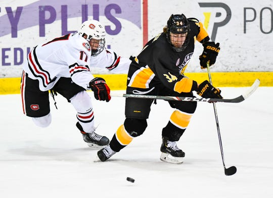 St. Cloud State's Thomas Rocco works against Chris Wilkie of Colorado College  during the first period of the Saturday, Nov. 16, 2019, game at the Herb Brooks National Hockey Center in St. Cloud.