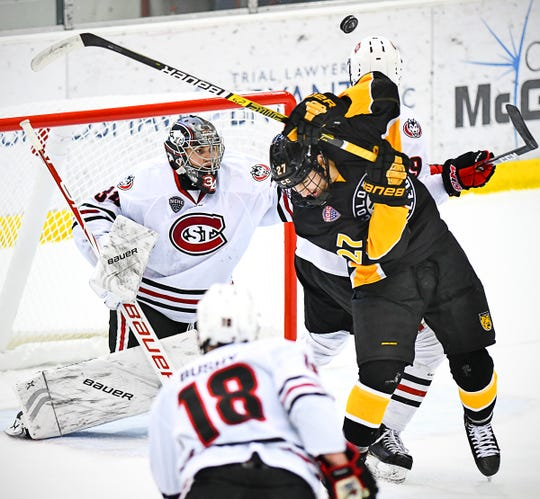 St. Cloud State goaltender David Hrenak watches as the puck bounces over the head of Josiah Slavin of Colorado College  during the first period of the Saturday, Nov. 16, 2019, game at the Herb Brooks National Hockey Center in St. Cloud.