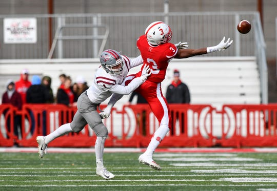 Ravi Alston reaches to make a catch for St. John's during the first half of the Saturday, Nov. 16, 2019, game at Clemens Stadium in Collegeville.