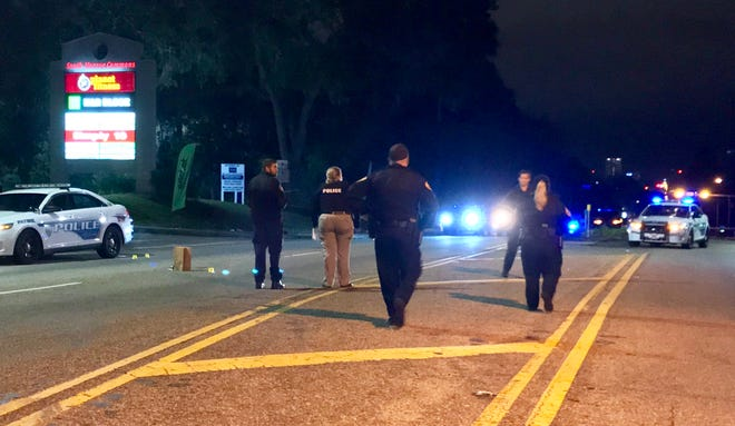 Tallahassee police respond to a shooting that injured three people early Sunday morning on South Monroe Street. Two of the victims, who were shot after a night at the North Florida Fair, later died.