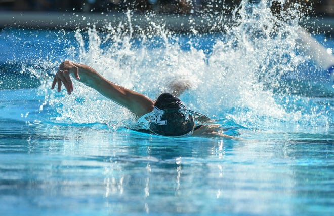 Sarah Evans, of Port St. Lucie High School, surfaces from her dive while competing in heat 3 of the girls 50 yard Freestyle preliminary during the Florida High School Athletic Association 2019 Swimming and Diving Class 3A State Championships on Saturday, Nov. 16, 2019, at Sailfish Splash Waterpark in Stuart.