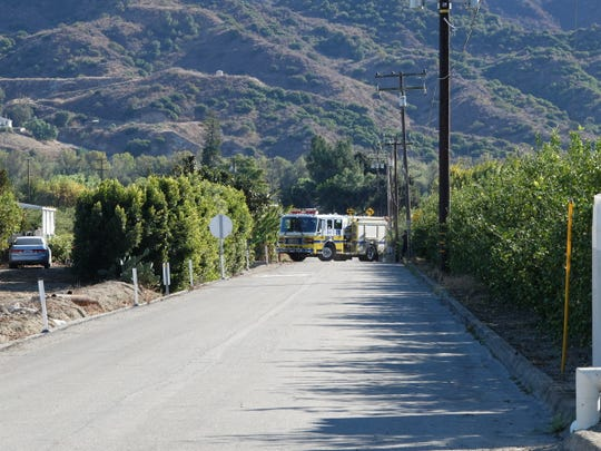 A Ventura County Fire Department truck leaves the scene of a fatal fire along Willard Road near Santa Paula on Sunday, Nov. 17, 2019.