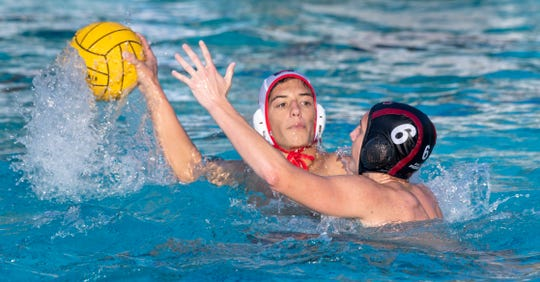 Mt. Whitney's Connor Bruton pressures Tulare Western's Joseph Machado in a Central Section Division III boys water polo championship on Saturday, November 16, 2019.