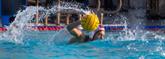 Tulare Western's Joseph Machado advances against Mt. Whitney in a Central Section Division III boys water polo championship on Saturday, November 16, 2019.